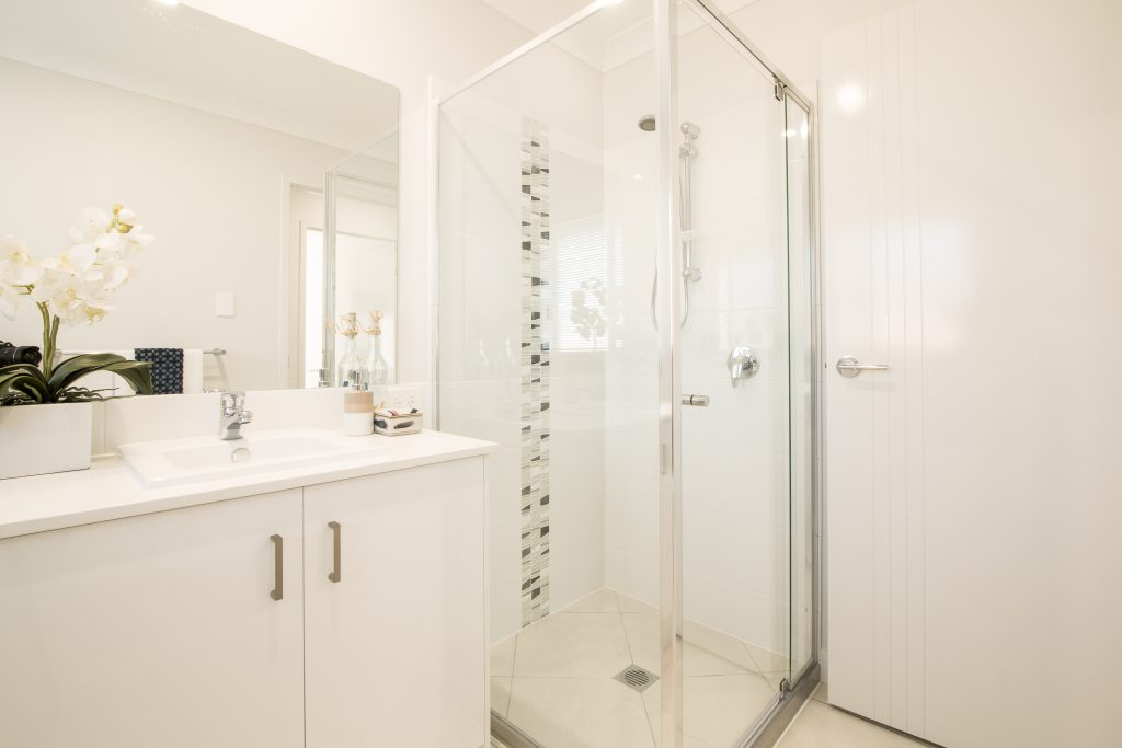 Frameless Mirror with Polished Silver Framed Nautilus Shower Screen