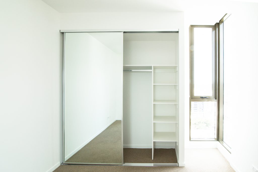 Frameless Mirror Robe Doors with Polished Silver Tracks & Built-in Wardrobe - Standard White Board Top Shelf & Shelving with a Chrome Hanging Rod