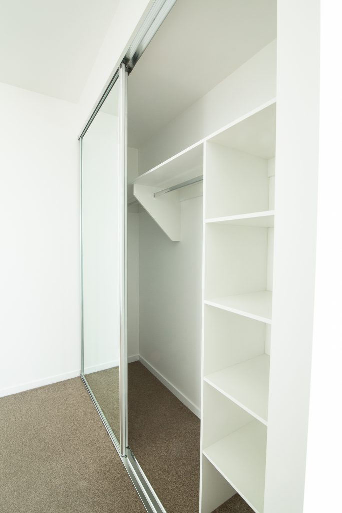 Frameless Mirror Robe Doors with Polished Silver Tracks & Built-in Wardrobe - Standard White Board Top Shelf & Shelving with Chrome Hanging Rod
