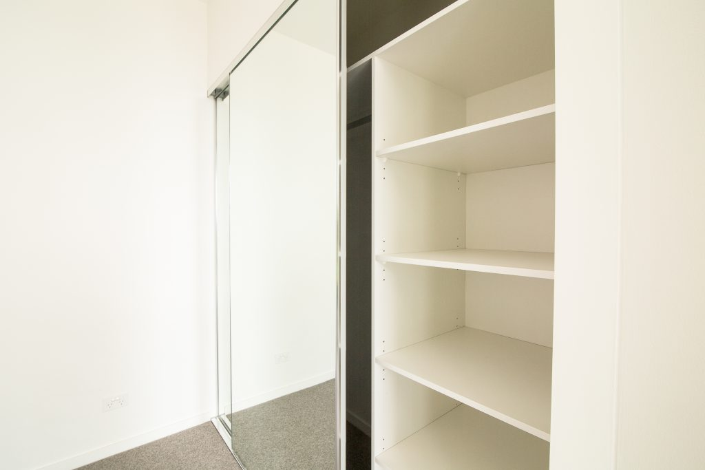 Frameless Mirror Robe Doors with Polished Silver Tracks & Built-in Wardrobe - Standard White Board Shelving