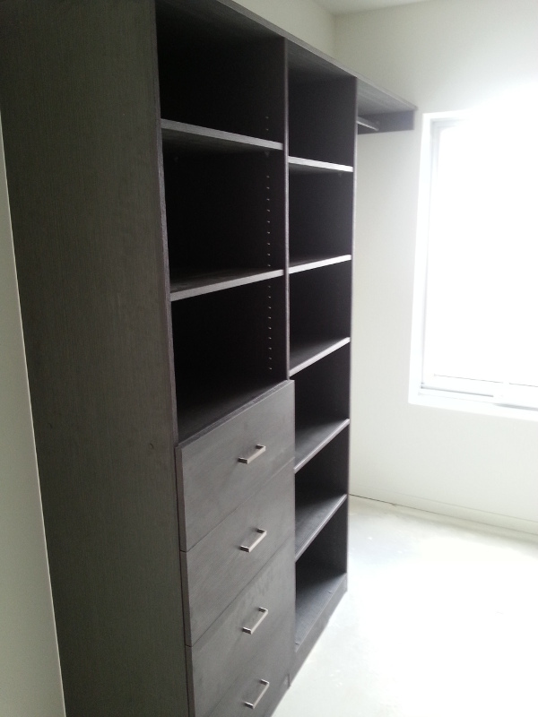 Walk-In-Wardrobe - Dark Brown Colour Board Shelving with Finger Pull Handles on the Bank of Drawers