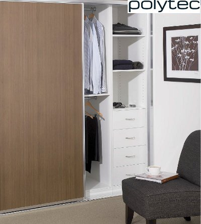 Built-In Wardrobe with Standard White Board Shelving, Bank of Drawers with Polished Silver Handles & Chrome Hanging Rods