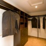 Walk-In-Wardrobe - Dark Brown Colour Board Shelving, Chrome Hanging Rods & Banks of Drawers with Polished Silver Handles