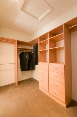 Walk-In-Wardrobe - Light Colour Board Shelving, Chrome Hanging Rods & Banks of Drawers with Polished Silver Handles