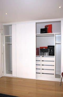 Vinyl Robe Doors with White Tracks & Built-In Wardrobe - Standard White Board Top Shelf, Chrome Hanging Rods & Bank of Sliding Drawers