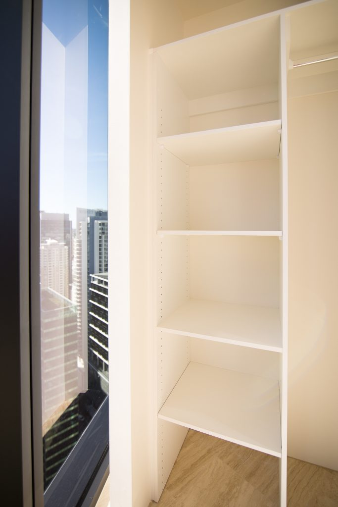 Built-in Wardrobe - Standard White Board Shelving with a Chrome Hanging Rod