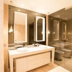 Frameless Vanity Mirrors with a Frameless Shower Screen in Grey Glass