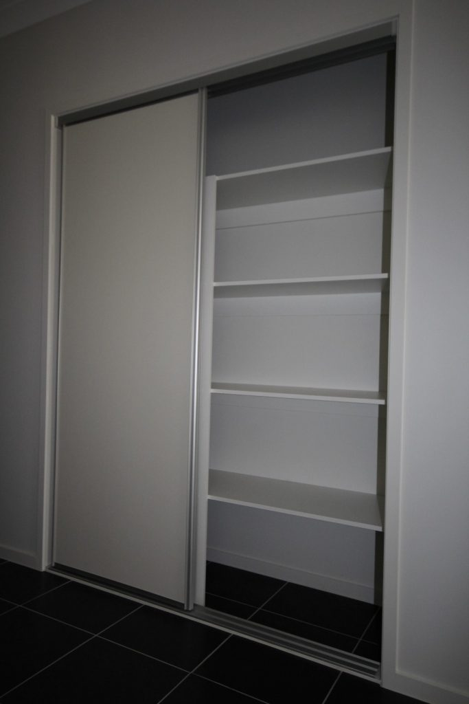 Polished Silver Framed Super White Robe Doors with Polished Silver Tracks & Built-In Wardrobe - Standard White Board Top Shelf & Shelving