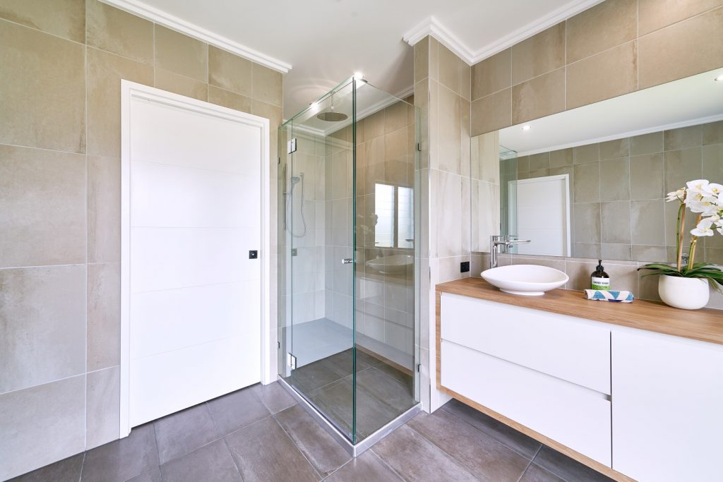 Frameless Shower Screen with Polished Silver Hinges, Shower Screen Knob and a Glass Header