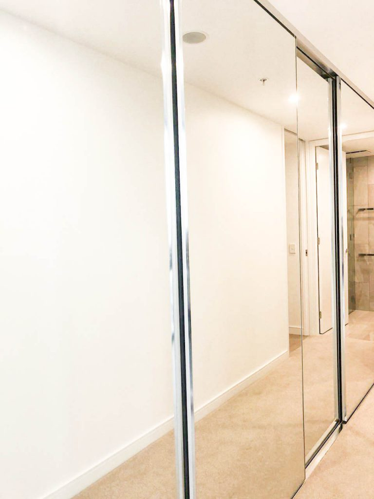 Frameless Mirror Robe Doors with Polished Silver Handles & Polished Silver Tracks