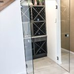 Wine Cellar - Frameless 10mm Glass Doors with Polished Silver Handles & Colour Board Shelving