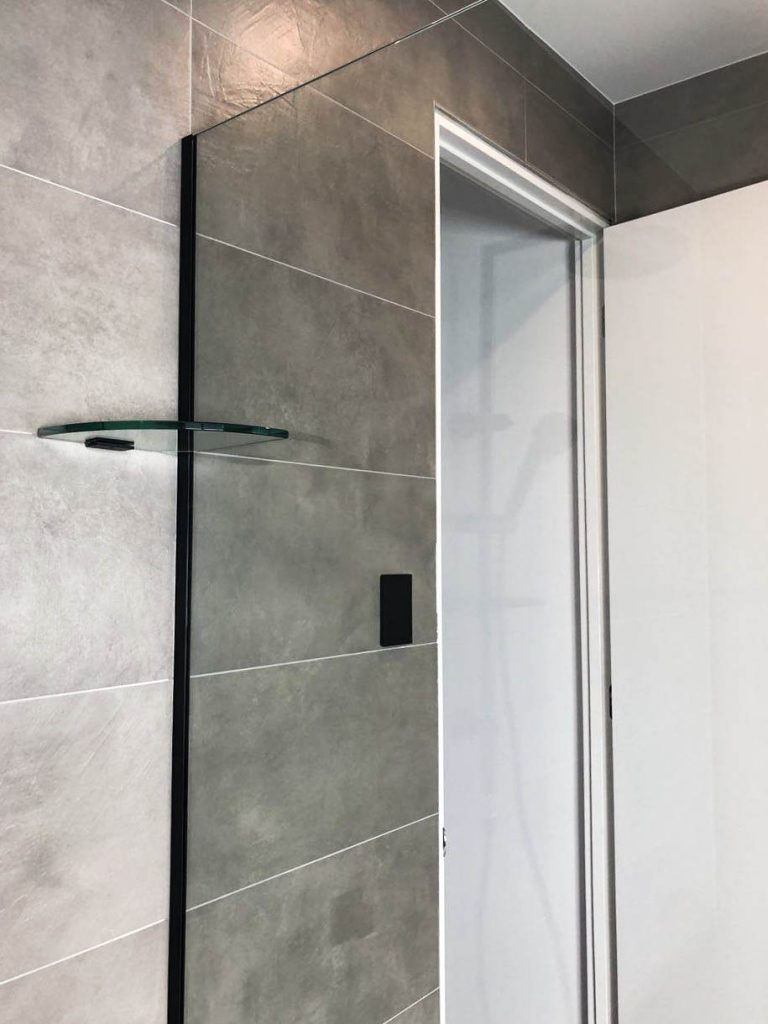 Frameless Shower Screen Panel with Black Channel & a Glass Brace