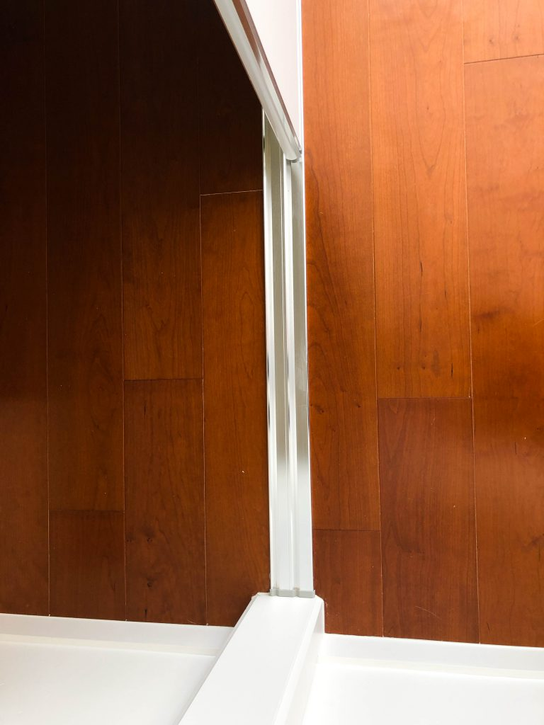 Polished Silver Framed Super White Robe Doors - Bottom Track View
