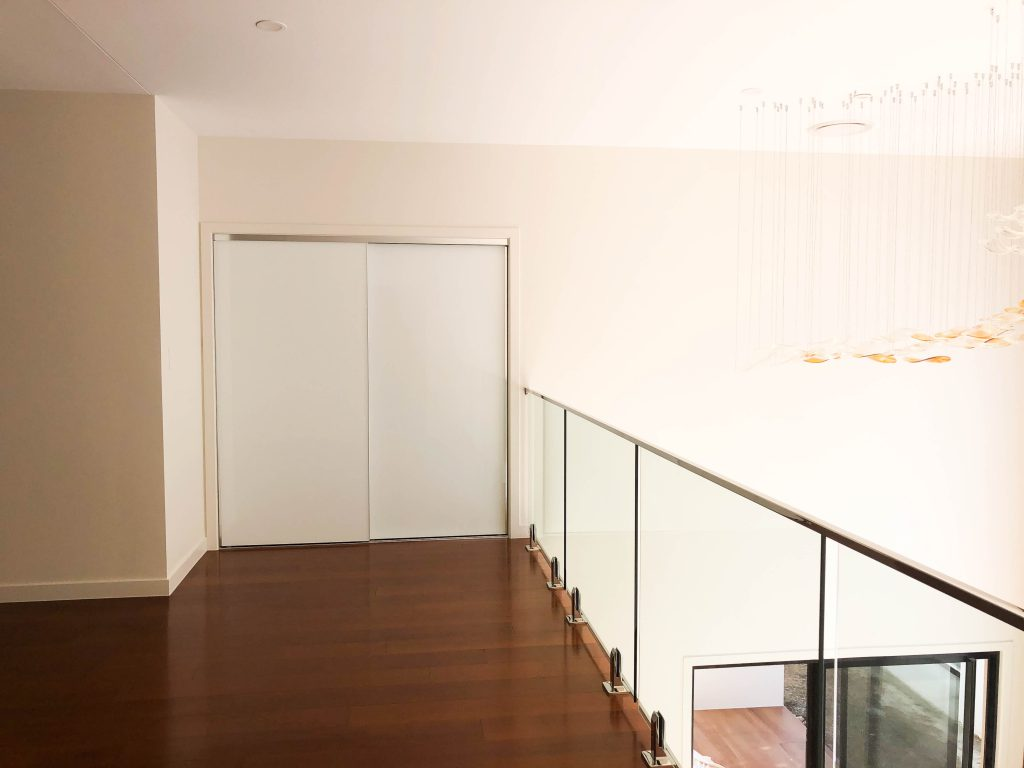 Frameless Super White Robe Doors with Polished Silver Handles & White Board Shelving