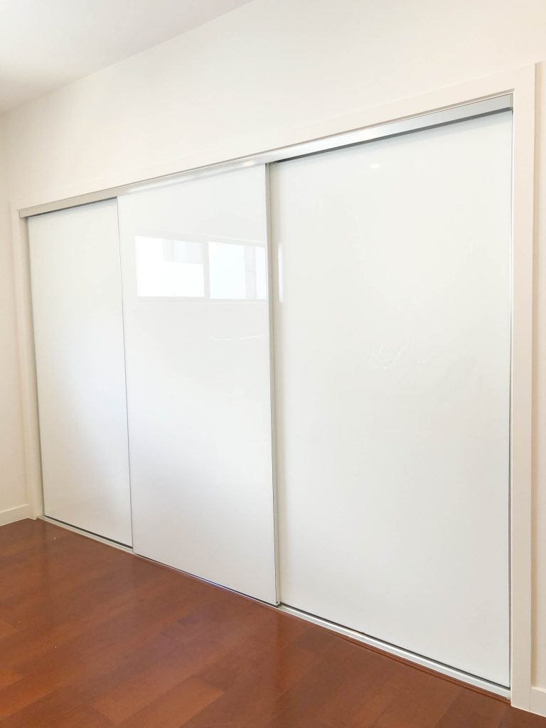 Frameless Super White Robe Doors with Polished Silver Handles