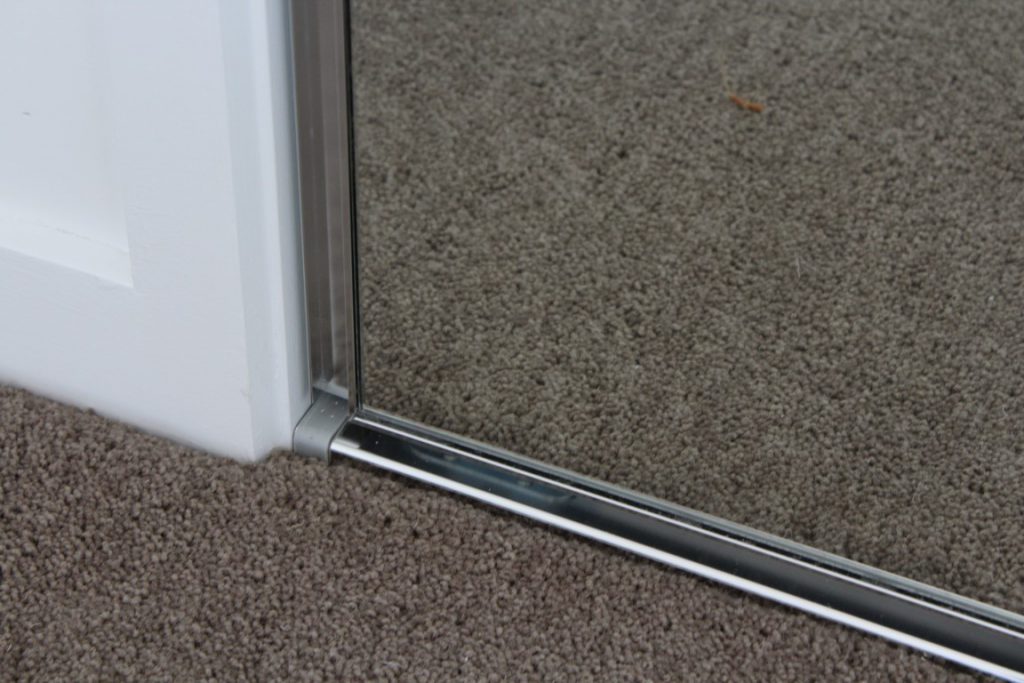 Frameless Mirror Robe Doors with Polished Silver Tracks & Handles - Bottom Track View