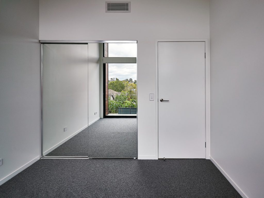 Frameless Mirror Robe Doors with Polished Silver Handles & Polished Silver