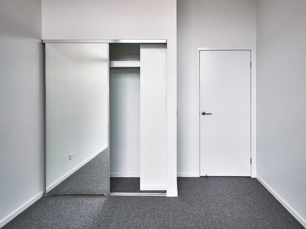 Frameless Mirror Robe Doors with Polished Silver Tracks & Built-in Wardrobe - Standard Whiteboard Top Shelf with Round Chrome Rod