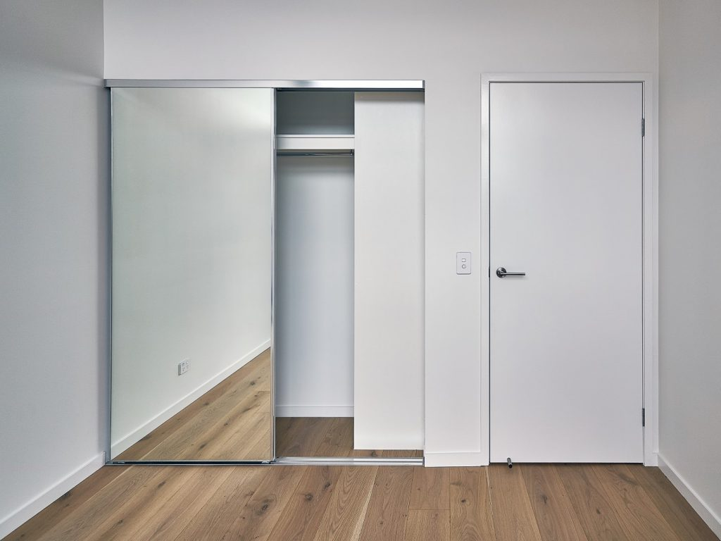 Frameless Mirror Robe Doors with Polished Silver Tracks & Built-in Wardrobe - Standard White Board Top Shelf with Round Chrome Rod