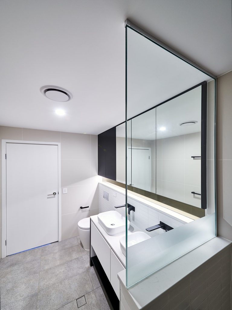 Frameless Shower Screen Panel with a Privacy Strip & a Matt Black & Mirror Shaving Cabinet