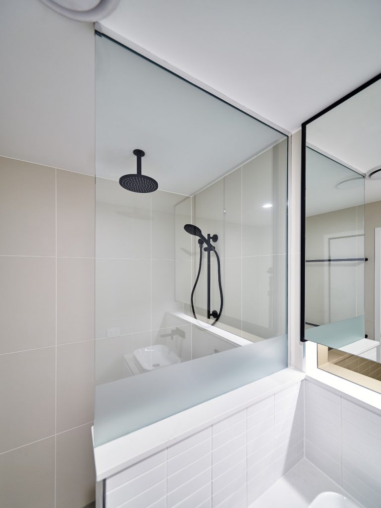 Frameless Shower Screen Panel with a Privacy Strip