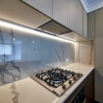 Clear Glass Splashback with Marble Behind