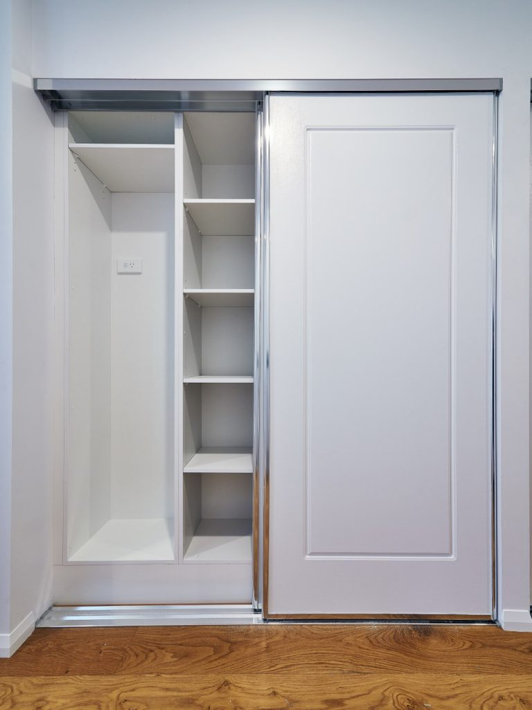 Colonial Polished Silver Framed Robe Doors with Standard White Board Shelving & a Broom Cupboard