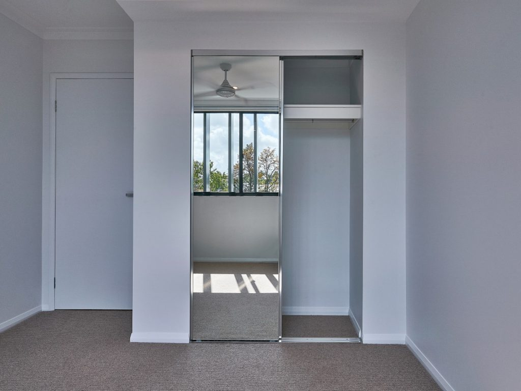 Polished Silver Framed Mirror Robe Doors with a Standard White Board Top Shelf & Chrome Hanging Rod