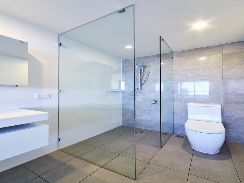 Frameless Shower Screen with Polished Silver Clips
