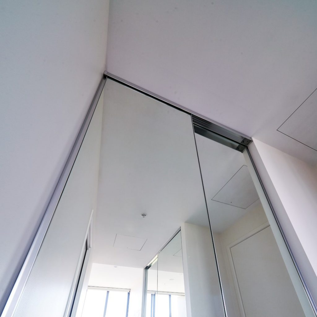 Frameless Mirror Robe Doors with Polished Silver Tracks & Handles - Top Track View