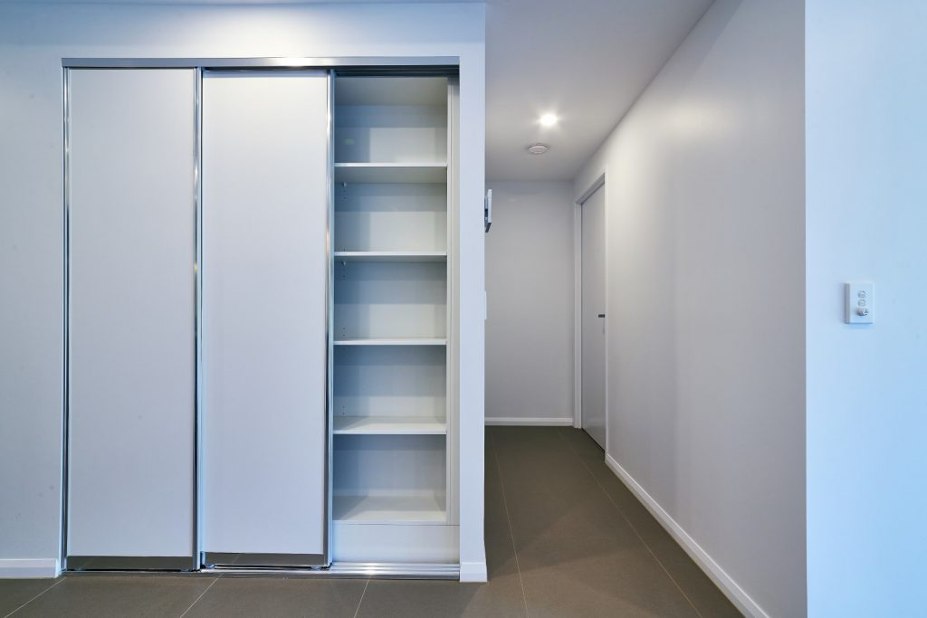 Slimline Polished Silver Robe Doors with Standard White Board Shelving