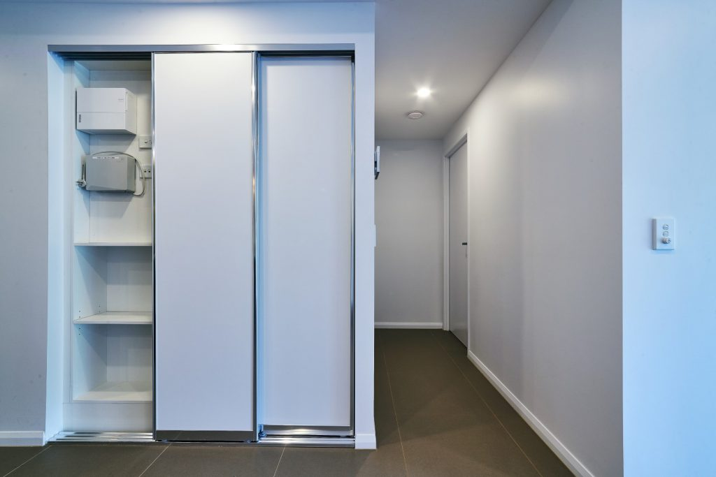 Polished Silver Framed Slimline Robe Doors with Polished Silver Triple Tracks & Standard White Board Shelving with an NBN