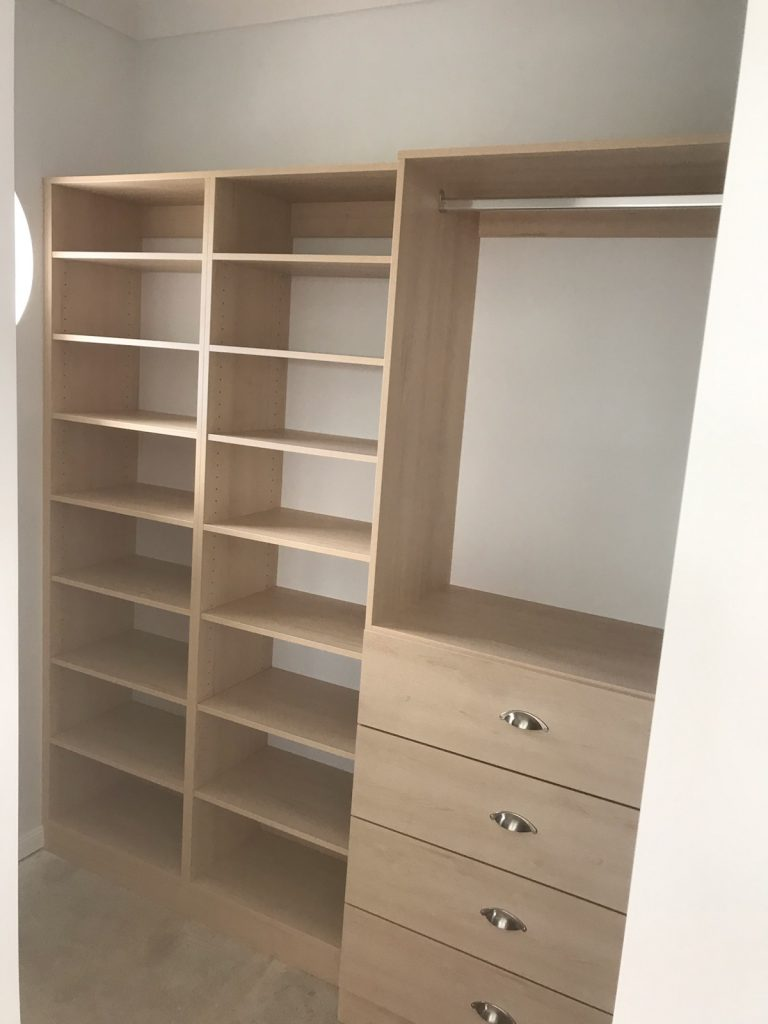 Walk-In Wardrobe - Polytec Nordic Oak Colour Board Shelving, Bank of Drawers with Polished Silver Florence Cup Handles & Chrome Hanging Rods