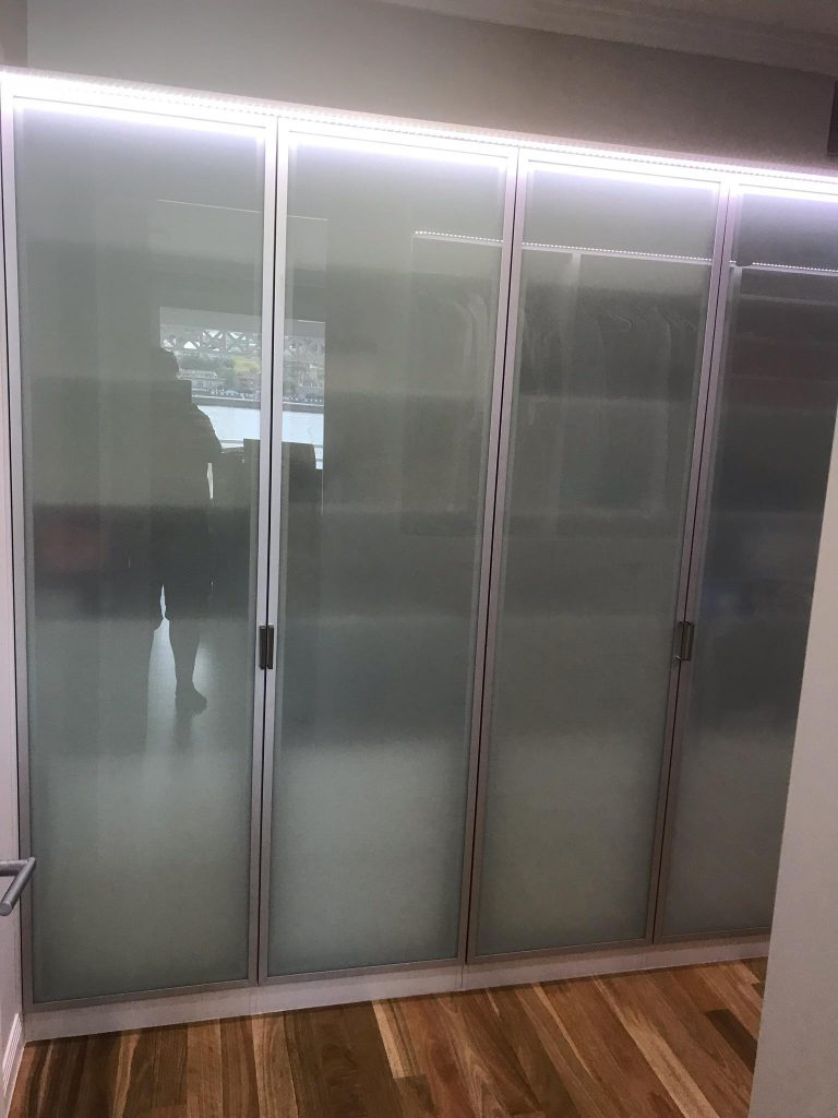 Polytec Frosted Glass Doors in Front of Chrome Hanging Rods