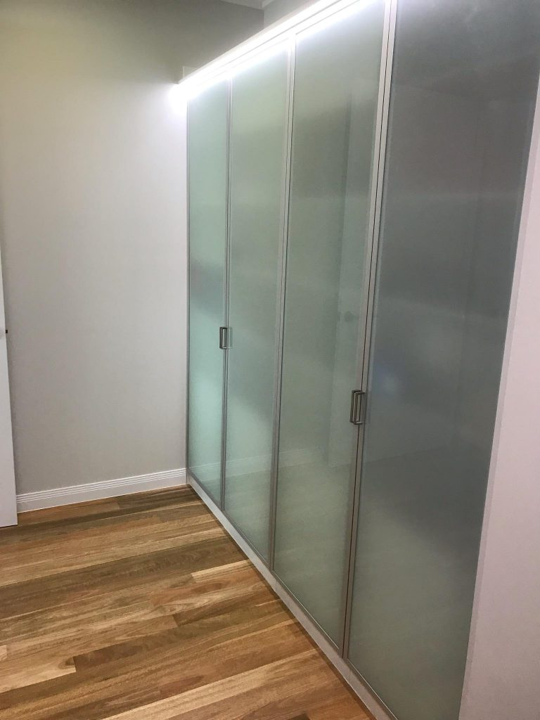 Polytec Frosted Glass Doors in Front of Chrome Hanging Rods & Shelving