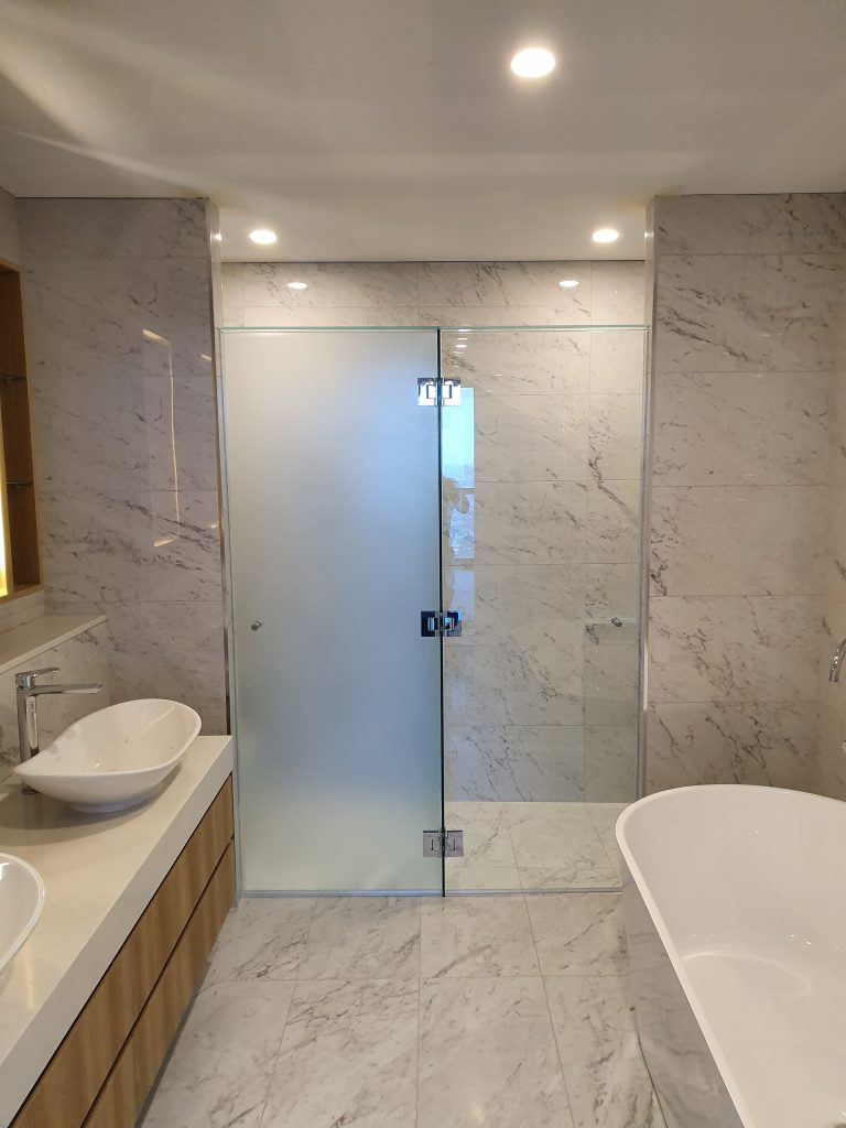 Frameless T-Screen for Shower & Toilet Area; LHS Panel is Acid Etched Glass, RHS Panel is Clear Glass, with Polished Silver Hinges