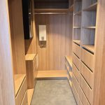 Walk-In Wardrobe - Polytec Natural Oak Colour Board Shelving, Banks of Drawers & Chrome Hanging Rod