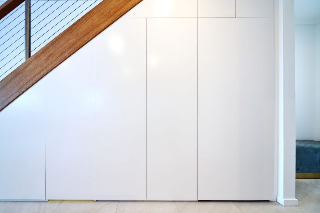 White Hinged Doors (under staircase) with Shelving & Drawers Behind