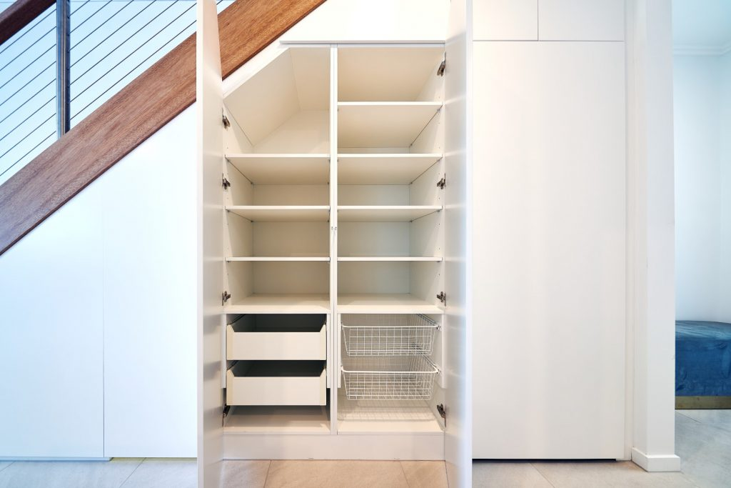 White Hinged Doors (under staircase) with White Board Shelving & Drawers