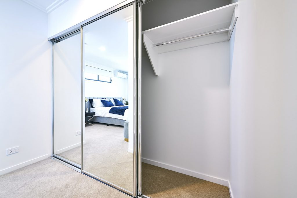 Polished Silver Framed Mirror Robe Doors with Polished Silver Tracks & White Board Top Shelf with Chrome Hanging Rod