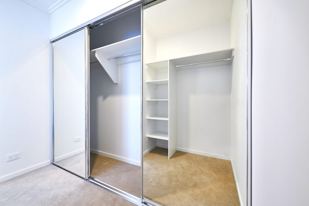 Polished Silver Framed Mirror Robe Doors with Polished Silver Tracks & White Board Top Shelf with Chrome Hanging Rods