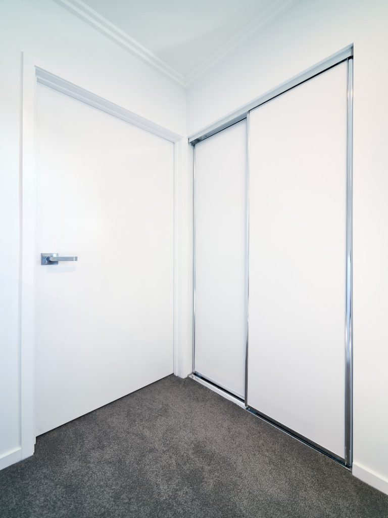 Polished Silver Framed Vinyl Robe Doors with Polished Silver Tracks