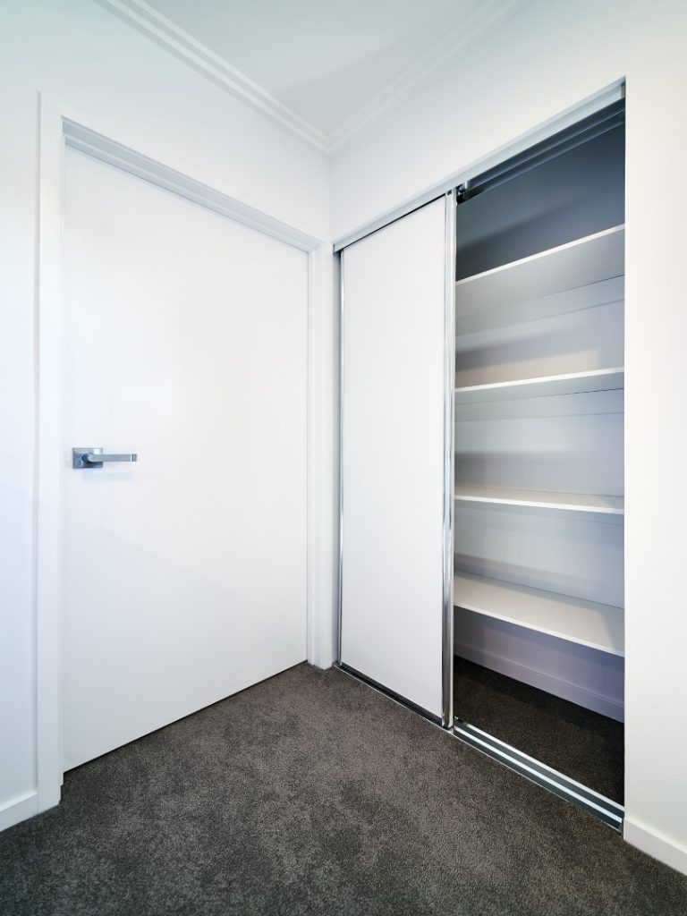 Polished Silver Framed Vinyl Robe Doors with Polished Silver Tracks & White Board Shelving