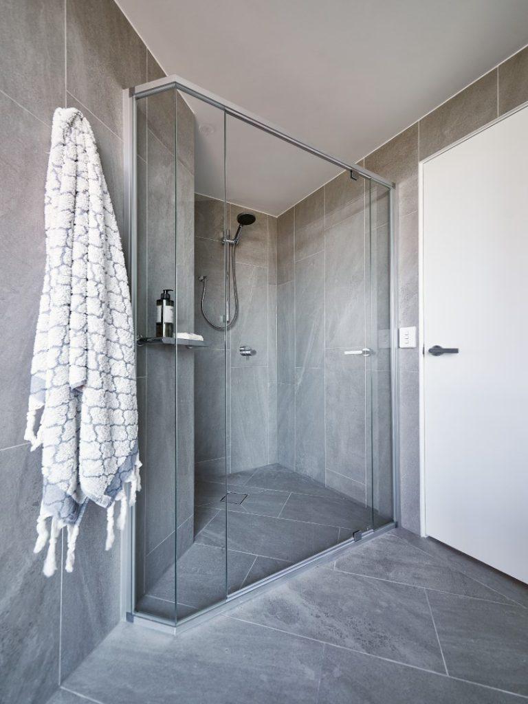 Polished Silver Framed Vogue Shower Screen with Polished Silver Pivots and Standard Shower Screen Knob