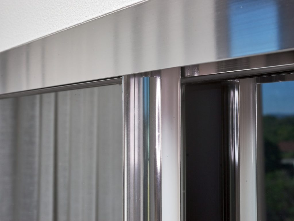 Polished Silver Framed Grey Mirror Robe Doors with Polished Silver Tracks (close up photo)