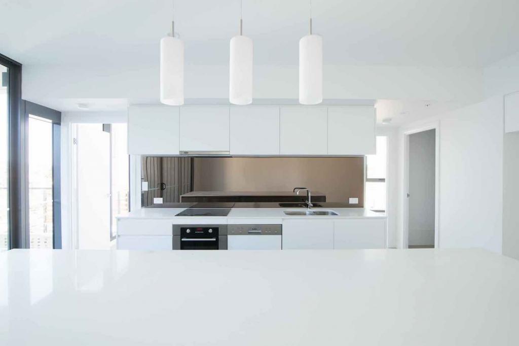 Bronze Mirror Splashback installed in white kitchen