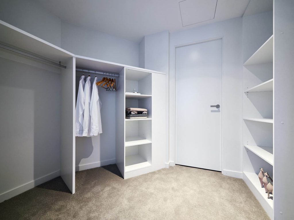 White Wardrobe Internals Installed with Hanging Rail And Shelves